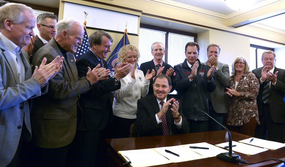 (Leah Hogsten | The Salt Lake Tribune) Gov. Gary R. Herbert, center, surrounded members Olympic/Paralympic Exploratory Committee Board Meeting after signing SCR009. The Salt Lake Olympic Exploratory Committee voted Wednesday to recommend that Utah should pursue hosting the Olympic and Paralympic Winter Games in 2030. If the U.S. Olympic Committee decides by March 31 to pursue the Games for 2026, and selects Salt Lake City as an interested city, the committee recommended that Utah leaders consider taking the next steps, including forming a candidature committee to pursue the opportunity, Wednesday, February 7, 2018.