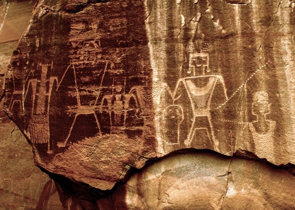 (Erin Alberty|The Salt Lake Tribune) Fremont petroglyphs show characters standing in a row at McConkie Ranch in Dry Fork Canyon near Vernal. Photo taken July 23, 2009.