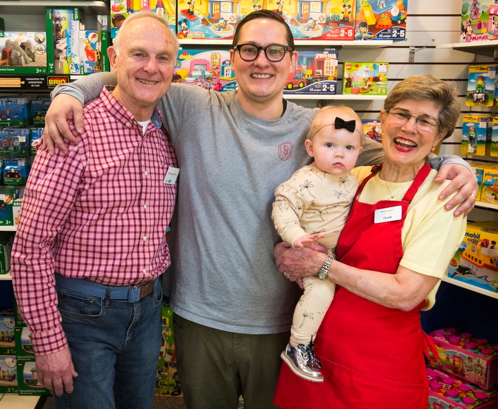 (Rick Egan | The Salt Lake Tribune) Bill Sartain with his son, Casey, and wife Diane and granddaughter Rosie, at the The Tutoring Toy, Thursday, March 22, 2018.