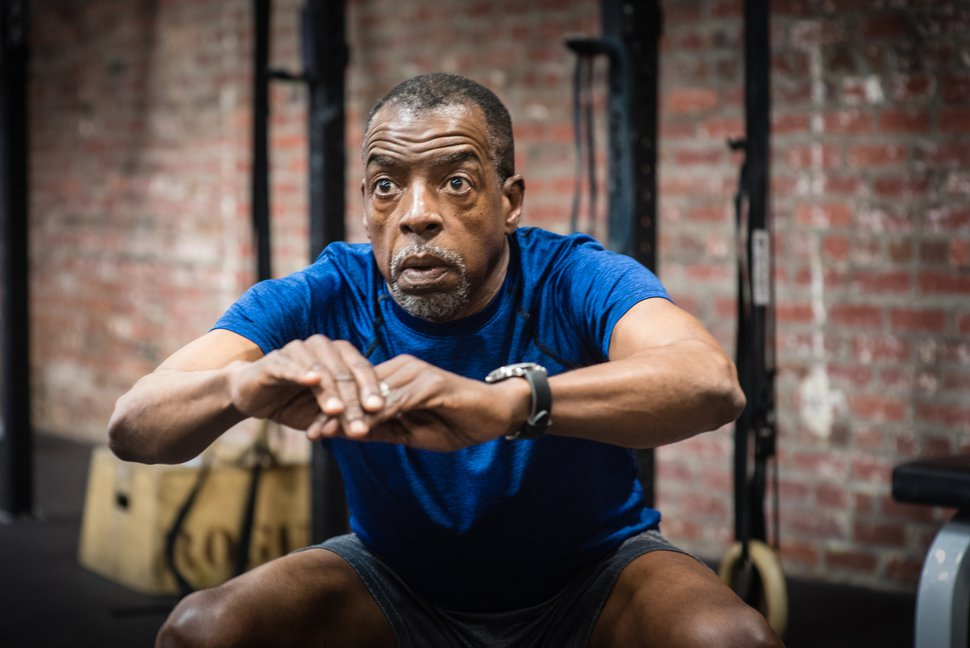 (Andre Chung | The Washington Post) Lewis Dawkins, who has been doing Crossfit for 7 months, works out at Crossfit DC. He likes it because for the price of membership you get the instructors and the classes, and compares it favorably to paying for a personal trainer at other gyms.