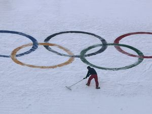 (AP Photo | Charlie Riedel, File) In this Feb. 10, 2018, file photo, a worker grooms the snow after installing a set of Olympic Rings on the ski jump hill at the 2018 Winter Olympics at the Alpensia Ski Jumping Center in Pyeongchang, South Korea. Ukraine wants to enter formal talks about hosting the Winter Olympics, the IOC said Monday.
