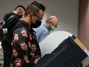 (Francisco Kjolseth  |  Tribune file photo) This Oct. 20, 2020, file photo shows people filling out their ballots on the first day of the state's in-person early voting at the Salt Lake County Government Center. Utah lawmakers are considering two bills promoting ranked choice voting, which would allow voters to rank candidates by preference instead of only picking one candidate for a position.