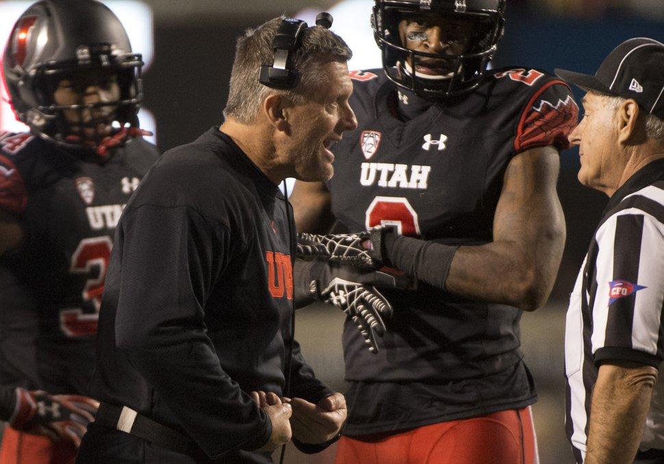 Rick Egan | The Salt Lake Tribune Utah Utes head coach Kyle Whittingham chats with the officials, in PAC-12 action, Utah vs. Oregon game, at Rice-Eccles Stadium, Saturday, November 8, 2014