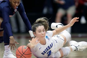 BYU guard Shaylee Gonzales, right, dives for a loose ball under Auburn guard Brooke Moore during the first half of a first-round game in the NCAA women's college basketball tournament in Stanford, Calif., Saturday, March 23, 2019. (AP Photo/Jeff Chiu)