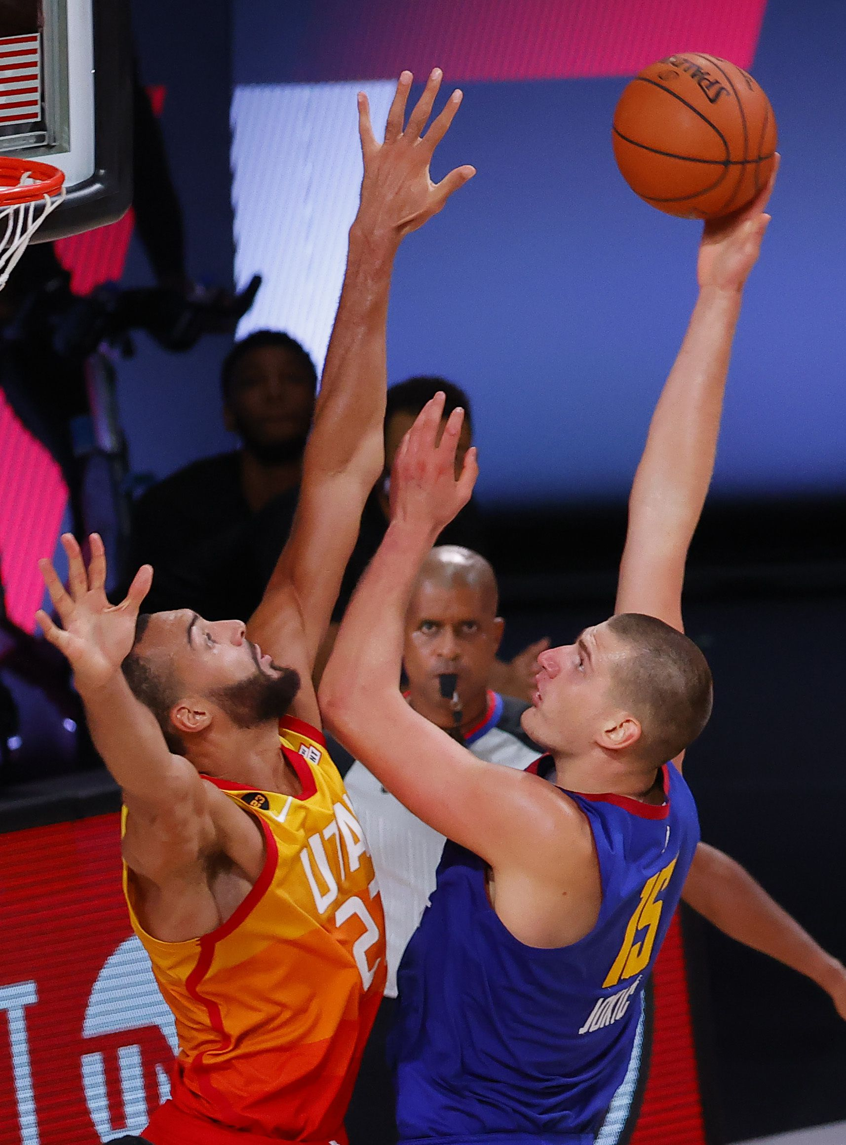 Denver Nuggets' Nikola Jokic, right, goes up for a shot against Utah Jazz's Rudy Gobert during the third quarter of Game 4 of an NBA basketball first-round playoff series, Sunday, Aug. 23, 2020, in Lake Buena Vista, Fla. (Kevin C. Cox/Pool Photo via AP)