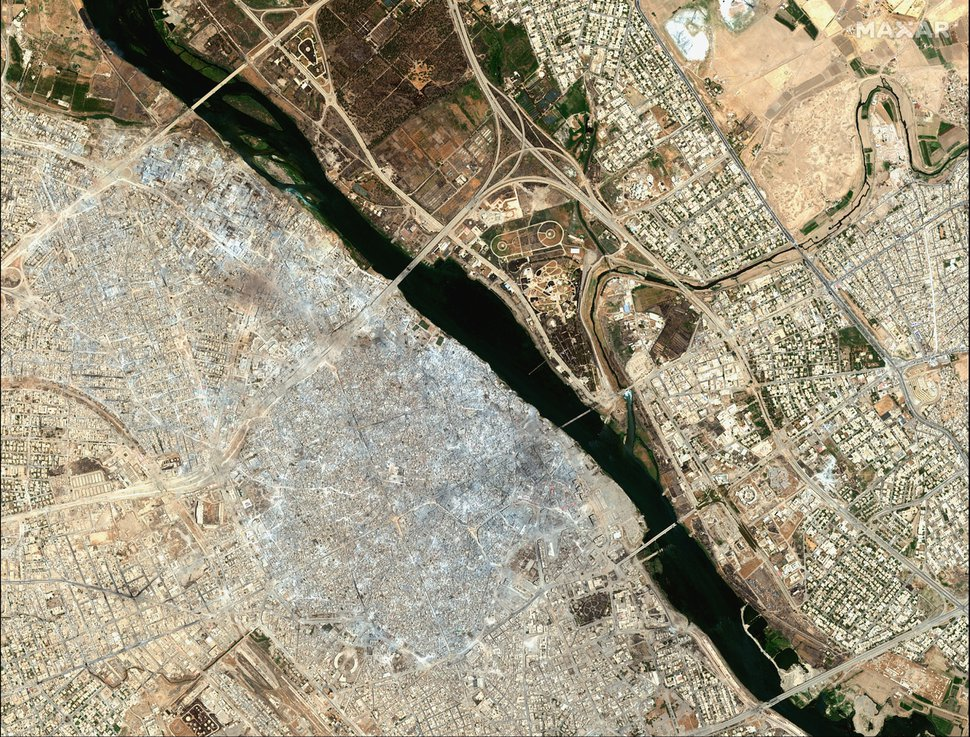 (Satellite image ©2019 Maxar Technologies via AP) This July 8, 2017, image provided by Maxar Technologies shows the Old City of Mosul, Iraq, left, after a punishing nine month battle to oust Islamic State militants.