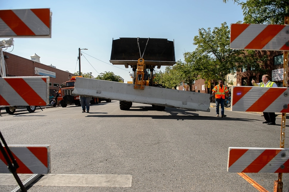 (Trent Nelson   The Salt Lake Tribune) Workers install barriers on Rio Grande in Salt Lake City to prevent auto traffic in hopes of stopping the drug traffic around the area, Friday September 1, 2017.