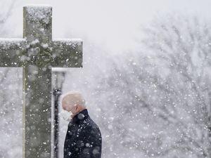 (Patrick Semansky | AP Photo) President Joe Biden departs after attending Mass at St. Joseph on the Brandywine Catholic Church as snow falls, Sunday, Feb. 7, 2021, in Wilmington, Del.