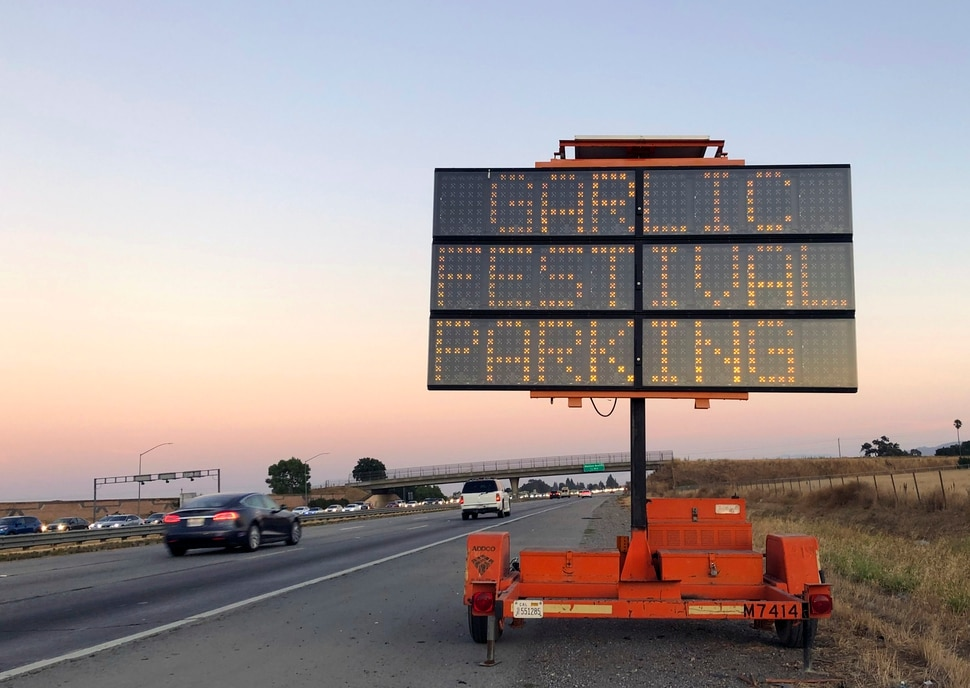 (Noah Berger | AP Photo) A road sign marks the Garlic Festival parking area in Gilroy, Calif., Sunday, July 28, 2019. Multiple people were hospitalized Sunday after a shooting at the annual food festival in Northern California, a hospital spokeswoman said.