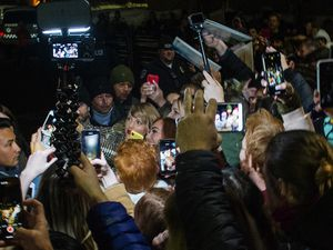 "Taylor Swift takes selfies with fans outside the Eccles Theatre before the premiere of her film ""Taylor Swift: Miss Americana."" on the opening night of the 2020 Sundance Film Festival, in Park City, Thursday, Jan. 23, 2020."