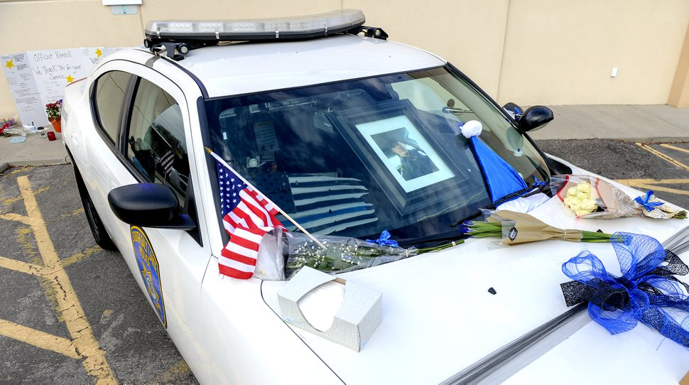 Leah Hogsten | The Salt Lake Tribune South Salt Lake police officer David Romrell's vehicle is decorated with flags, flowers, notes of gratitude and bows in the police department parking lot. South Salt Lake Police Department detective Gary Keller, Lt. Jim Anderson and Unified Police Department investigator Melody Gray held a press conference Nov. 27, 2018 to announce the Dec. 5th funeral procession date for South Salt Lake police officer David Romrell, who died Saturday evening after he was struck by a car during a confrontation between police and two burglary suspects.