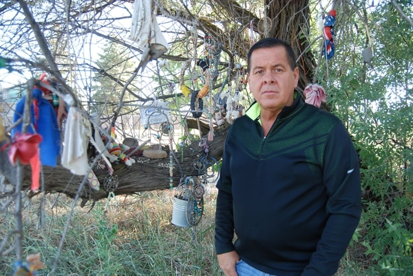 (Brian Maffly | The Salt Lake Tribune) Darren Parry, chairman of the Northwestern Band of the Shoshone Nation, is leading efforts to commemorate the site of the 1863 Bear River Massacre outside Preston, Idaho. He is pictured here beside a tree on U.S. Highway 91 where people have hung offerings to honor Native Americans who died in what is believed to be the deadliest attack by U.S. soldiers during the West's wars.