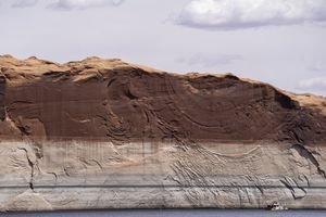 (Rick Egan   The Salt Lake Tribune) A houseboat on Lake Powell, seen on Tuesday, May 18, 2021, highlights the 140-foot difference between today's lake level and the lake's high-water mark.