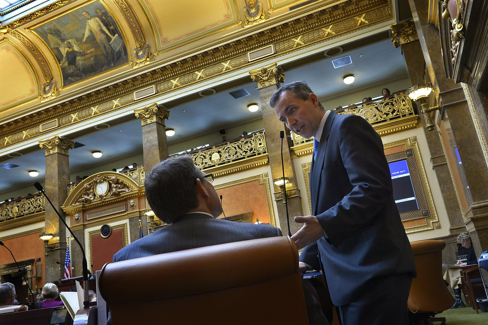 Scott Sommerdorf | The Salt Lake Tribune Rep. Dan McCay, R-Riverton, speaks with Rep. Brad Last, R-Hurricane, on the floor of the House of Representatives, Thursday, Feb. 6, 2014.