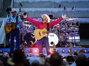 (Isaac Hale | Special to The Tribune) Garth Brooks performs with his band during a stop on their stadium tour held at Rice-Eccles Stadium in Salt Lake City on Saturday, July 17, 2021.