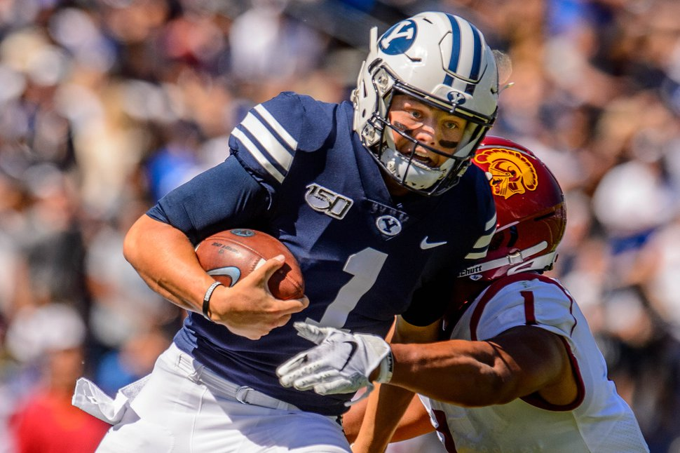(Trent Nelson | The Salt Lake Tribune) Brigham Young Cougars quarterback Zach Wilson (1) runs the ball as BYU hosts USC, NCAA football in Provo on Saturday Sept. 14, 2019.