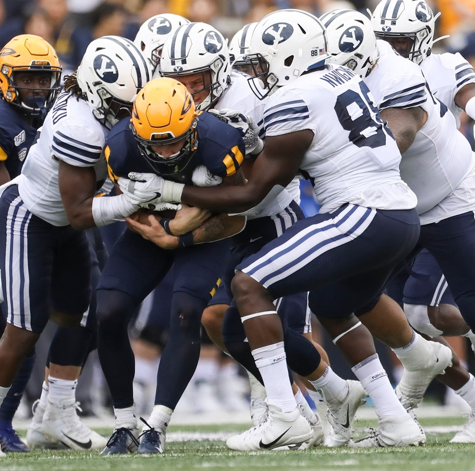 University of Toledo's quarterback Mitchell Guadagni (6) is brought down by a pack of Brigham Young's defense during a college football game at the Glass Bowl in Toledo, Ohio on Saturday,September 28, 2019. UT defeated BYU 28-21. (Rebecca Benson/ The Blade via AP)
