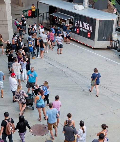 (Michael Mangum | Special to the Tribune) Patrons line up at the Bandera Brisket truck during the Food Truck & Brewery Battle at The Gateway in Salt Lake City, Utah, on Saturday, August 12, 2017.