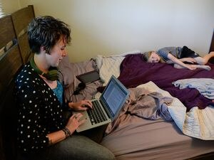 (Francisco Kjolseth  |  Tribune file photo) This May 29, 2020, file photo shows Kat Webb, then a recent Utah State University graduate and reporter, with her son Hendrix Twitchell as she overlooks one of her deadline reporting pieces related to COVID-19 and the Navajo Nation. When the coronavirus arrived last year, Webb, like many Utahns, found herself working from home.