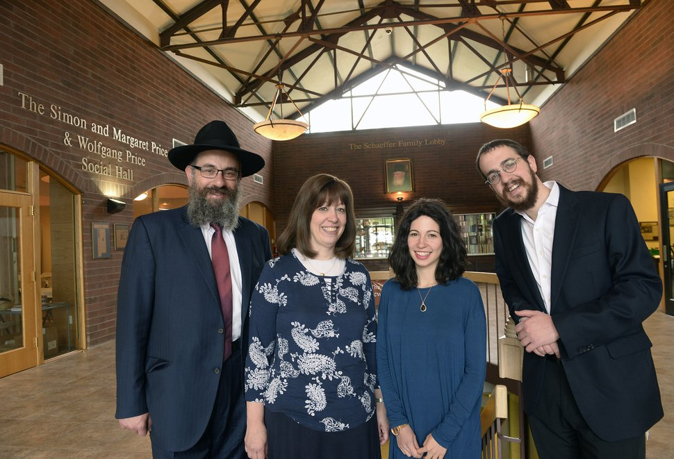(Al Hartmann | The Salt Lake Tribune) Rabbi Benny Zippel, left, wife Sharonne Zippel, Sheina Zippel and her husband, Rabbi Avremi Zippel, at the Chabad office in Salt Lake City Friday May 11, 2018. Chabad Lubavitch synagogue is celebrating its 25th anniversary in Utah.