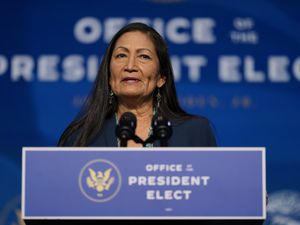 FILE - In this Dec. 20, 2020, file photo the Biden administration's nominee for Secretary of Interior, Rep. Deb Haaland, D-N.M., speaks at The Queen Theater in Wilmington Del. (AP Photo/Carolyn Kaster, File)