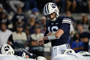 (Francisco Kjolseth | The Salt Lake Tribune) Brigham Young Cougars quarterback Baylor Romney (16) checks the play at the line of scrimmage, as BYU and the South Florida Bulls face off at LaVell Edwards Stadium on Saturday, Sept. 25, 2021.
