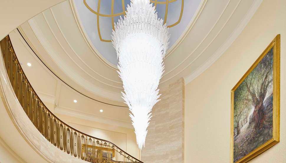 (Photo courtesy of The Church of Jesus Christ of Latter-day Saints) The grand staircase chandelier in the Rome Italy Temple was inspired by Chihuly. It incorporates the Venetian leaf pattern.