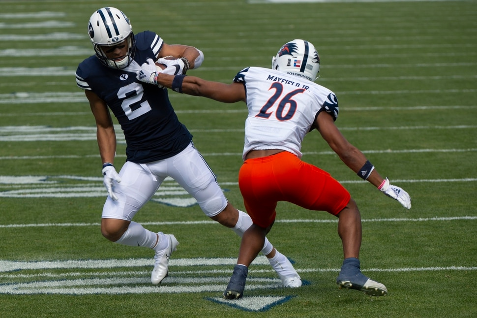 (Rick Egan   The Salt Lake Tribune) Brigham Young Cougars wide receiver Neil Pau'u (2) has the ball stripped by UTSA Roadrunners cornerback Corey Mayfield Jr. (26), resulting in a fumble, in football action between the Brigham Young Cougars and the UTSA Roadrunners, at Lavell Edwards stadium, Saturday, Oct. 10, 2020.