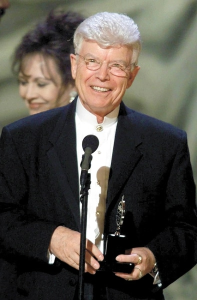 (Suzanne Plunkett | AP photo) Fred C. Adams, of The Utah Shakespearean Festival, of Cedar City, Utah, accepts their award at the 54th annual Tony Awards ceremonies Sunday, June 4, 2000, at Radio City Music Hall in New York. The group received the Regional Theatre Tony Award which is given to a regional theatre company that has displayed a continuous level of artistic achievement and includes a $25,000 grant.