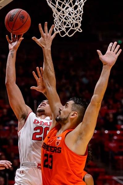 (Trent Nelson | The Salt Lake Tribune) Utah Utes forward Timmy Allen (20) shoots, defended by Oregon State Beavers center Gligorije Rakocevic (23) as Utah hosts Oregon State, NCAA basketball in Salt Lake City on Saturday Feb. 2, 2019.