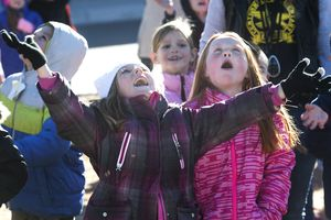 (Rick Egan  |  The Salt Lake Tribune) First graders Jaxie Marx and Rebecca Marshallwatch the skies as Santa and Mrs Claus arrive in a helicopter, at Centennial Elementary School, in Roosevelt, Utah, as volunteer pilots from the Utah Wing of Angel Flight West,  brought school supplies and gifts to students  on their annual Santa Flight. Friday, December 8, 2017.