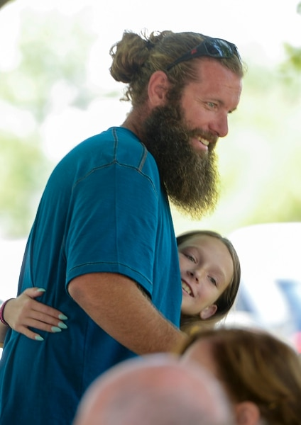 Leah Hogsten | The Salt Lake Tribune Nathan Runyon, brother to Rachael Runyon is hugged as family, friends and child advocates gathered to celebrate the life of Rachael Runyan, the 3-year-old whose 1982 killing inspired UtahÕs Amber Alert system. Rachael Runyan's mother, Elaine Runyan, has made it her lifeÕs work to advocate for missing and exploited children.