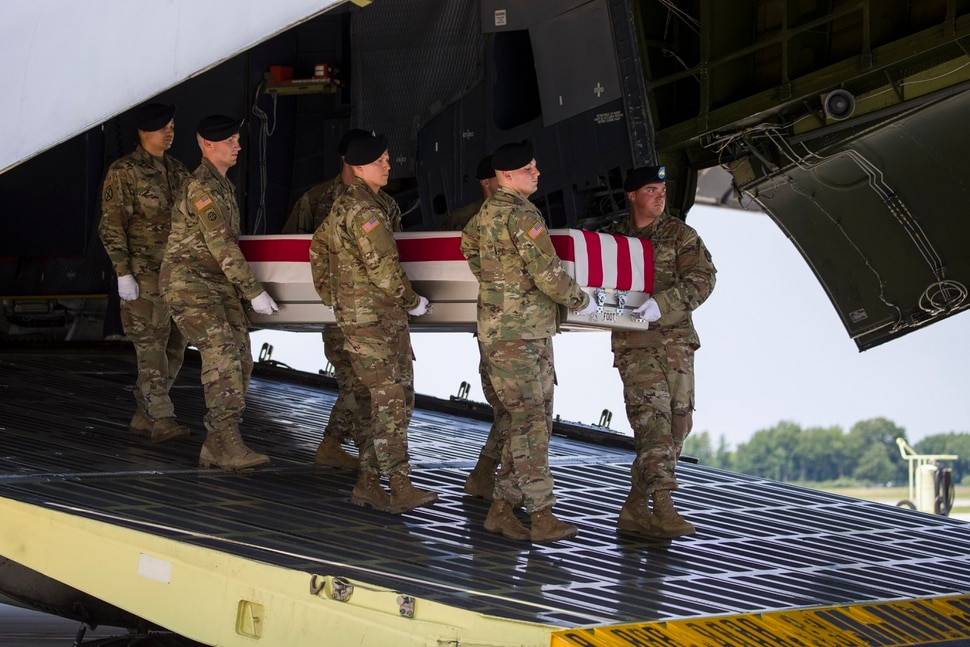 (Alex Brandon | AP Photo) An Army carry team moves a transfer case containing the remains of U.S. Army Sgt. 1st Class Elliott J. Robbins, at Dover Air Force Base, Del., Tuesday, July 2, 2019. According to the Department of Defense, Robbins, of Ogden, Utah, assigned to the 10th Special Forces Group died while supporting Operation Freedom's Sentinel.