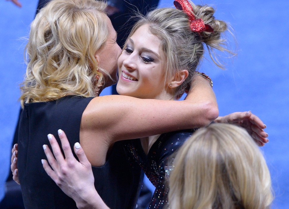 Leah Hogsten | The Salt Lake Tribune Utah's Sabrina Schwab is hugged by coach Megan Marsden after she took first place in floor exercise with a score of 9.925. University of Utah No. 6 gymnasts defeated No. 11 Oregon State during their Pac-12 meet in Salt Lake City, January 23, 2016.