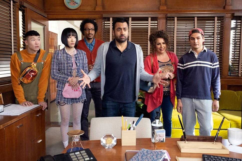 "(Photo courtesy Colleen Hayes/NBC) Joel Kim Booster as Jun Ho, Poppy Liu as Mei Lin, Samba Schutte as Hakim, Kal Penn as Garrett, Diana Marie Riva as Griselda and Moses Storm as Brady in ""Sunnyside."""