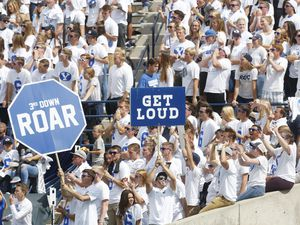 (Kim Raff   AP) BYU fans cheer in the first half during an NCAA college football game against Wisconsin, in Provo on Sept. 16, 2017. The Cougars are expected to receive a formal invitation to join the Big 12 Conference on Friday morning.