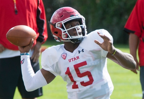(Rick Egan | The Salt Lake Tribune) University of Utah QB Jason Shelley (15) throws a pass in football practice, Monday, July 31, 2017.