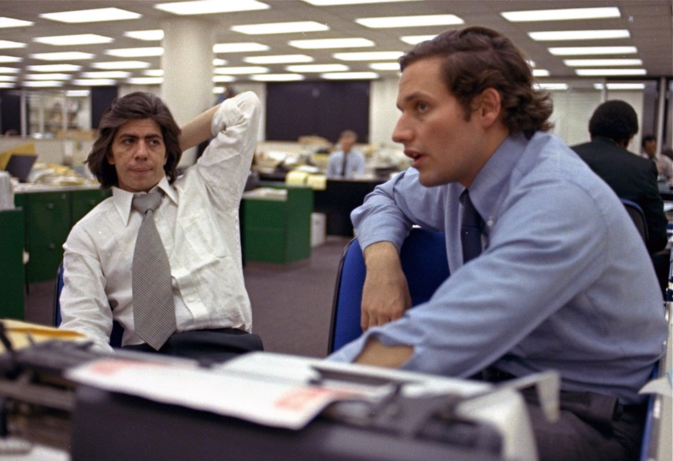 (AP Photo, File) In this May 7, 1973, file photo, reporters Bob Woodward, right, and Carl Bernstein, whose reporting of the Watergate case won them a Pulitzer Prize, sit in the newsroom of The Washington Post.