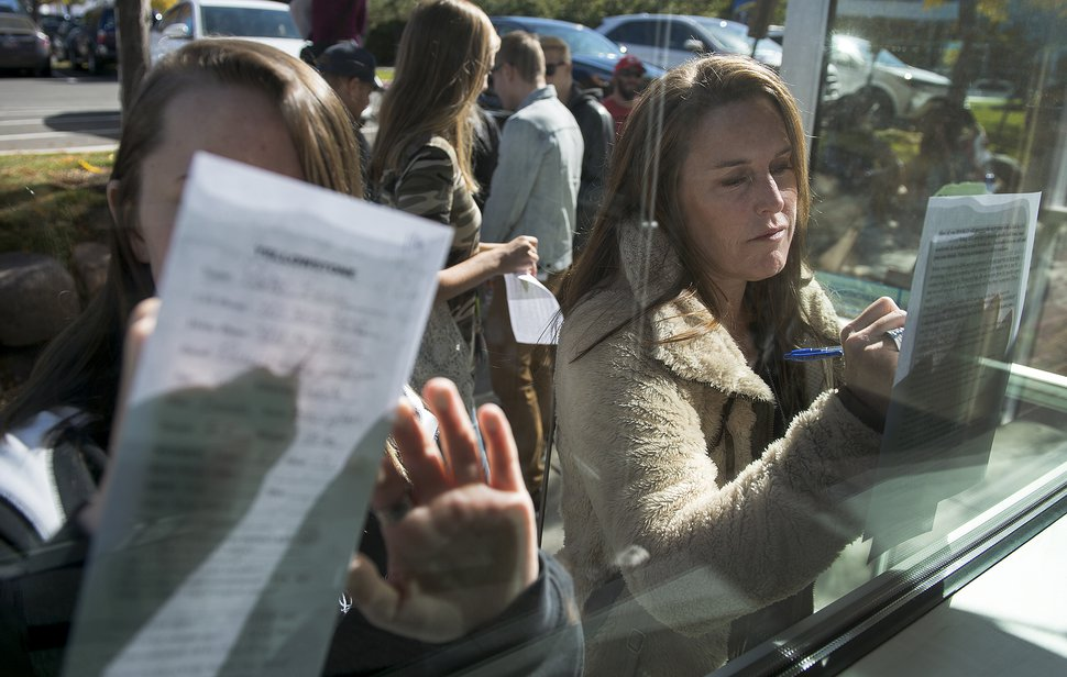 (Leah Hogsten | The Salt Lake Tribune) l-r Parker Kvinge, 16, and her mother Laura Kvinge fill out required paperwork during Saturday's casting call at Salt Lake Community College, October 14, 2017 to play an extra for the upcoming series