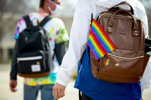 (Isaac Hale | Special to The Tribune) A Brigham Young University student sports various rainbow-colored items on his backpack in support of Rainbow Day as he walks with his friends on the campus of BYU in Provo on Thursday, March 4, 2021. A student at the school was recently called a Mormon term associated with an anti-Christ by a professor. The school has remained silent.