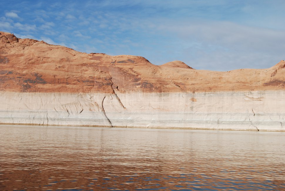 (Brian Maffly | The Salt Lake Tribune) Change in water level shows about 90 feet of rock near Bullfrog Bay on Nov. 29, 2018, that has been exposed since Lake Powell has receded.