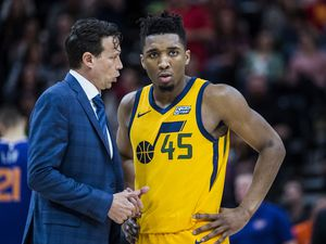 (Chris Detrick  |  The Salt Lake Tribune)  Utah Jazz head coach Quin Snyder talks with Utah Jazz guard Donovan Mitchell (45) during a game at Vivint Smart Home Arena. Snyder, Mitchell and the rest of the Jazz are finding the NBA's post-bubble environment ot be a challenge.