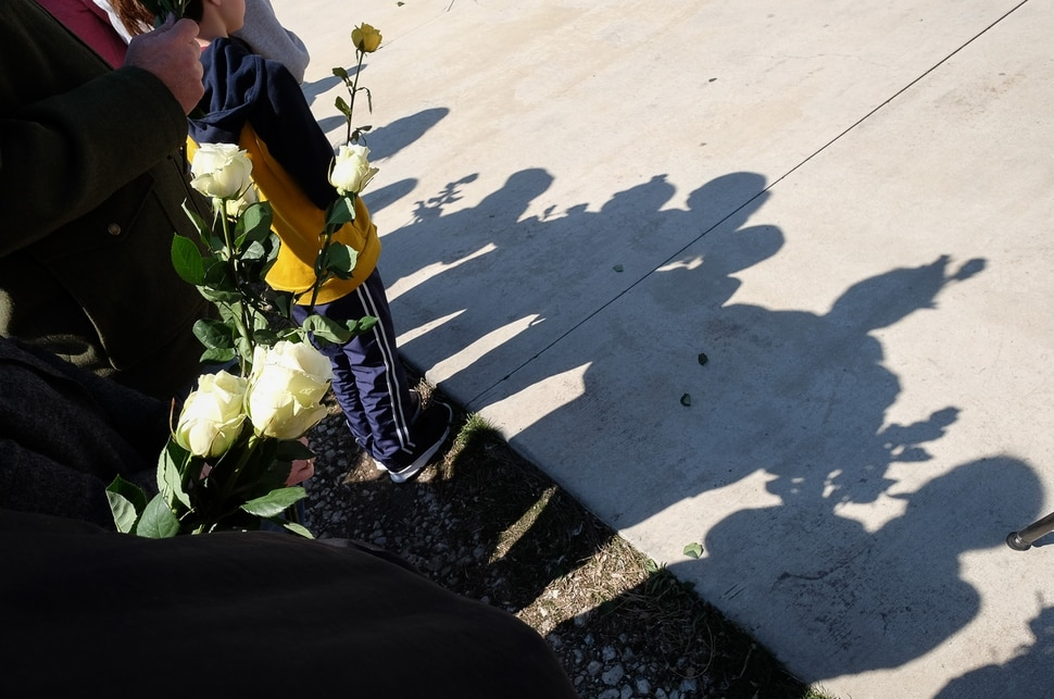 (Francisco Kjolseth | The Salt Lake Tribune) People line up with flowers outside of the Al Sahaba Mosque in Orem to show love and support for the Muslim community following Friday preyer services after the tragic Muslim shootings in New Zealand.