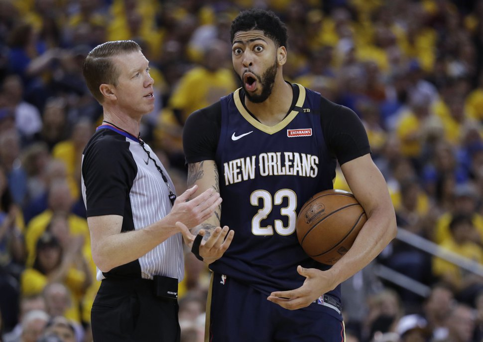 New Orleans Pelicans' Anthony Davis argues a call during the first half in Game 5 of an NBA basketball second-round playoff series against the Golden State Warriors on Tuesday, May 8, 2018, in Oakland, Calif. (AP Photo/Marcio Jose Sanchez)
