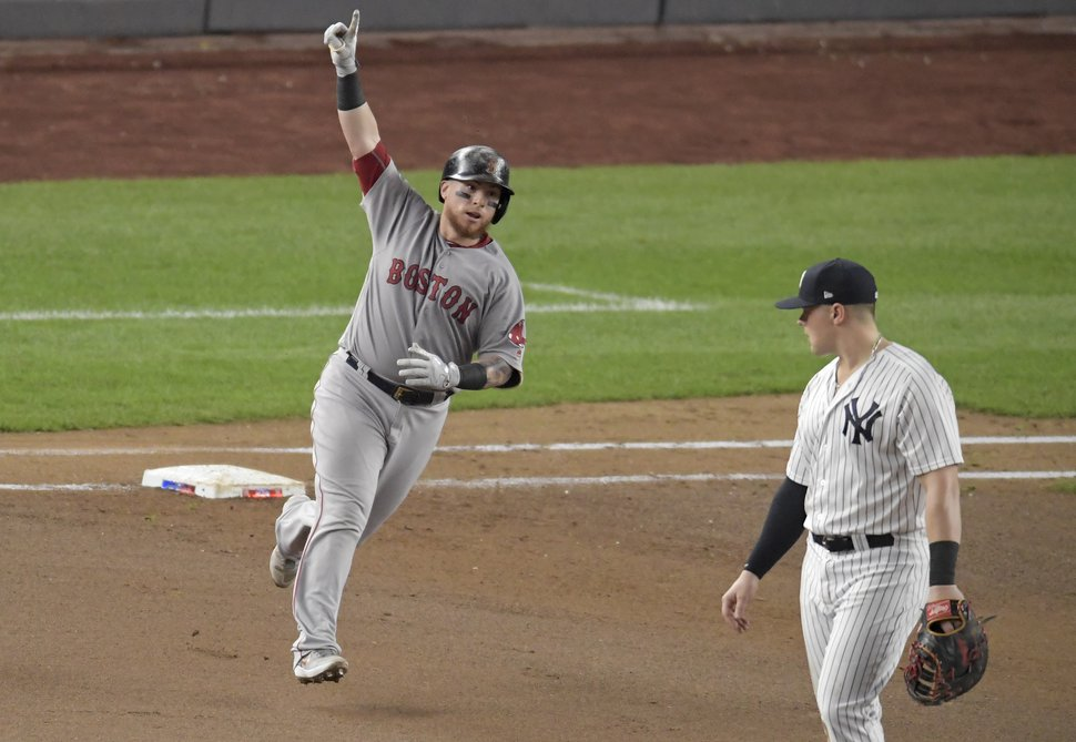 Boston Red Sox's Christian Vazquez reacts as he rounds first base after connecting for a solo home run against the New York Yankees during the fourth inning of Game 4 of baseball's American League Division Series, Tuesday, Oct. 9, 2018, in New York. (AP Photo/Bill Kostroun)