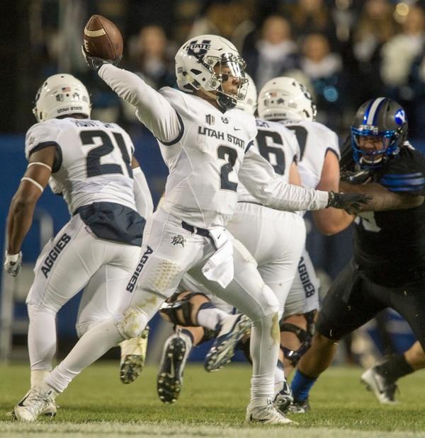 Rick Egan   The Salt Lake Tribune Utah State Aggies quarterback Kent Myers (2) throws a pass, In football action, BYU vs Utah State, at Lavell Edwards Stadium in Provo, Saturday, November 26, 2016.