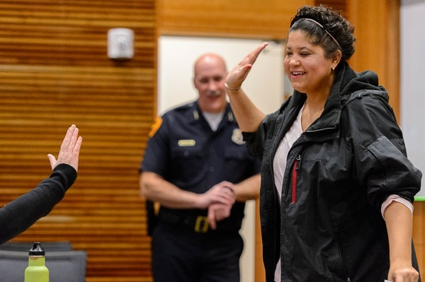 Trent Nelson | The Salt Lake Tribune Lex Scott of Black Lives Matter — Utah gives a high-five at a meeting of the Community Advisory Group, Wednesday, Jan. 18, 2017. The CAG meets with police and city representatives every other week. At rear is Salt Lake City Police Chief Mike Brown.