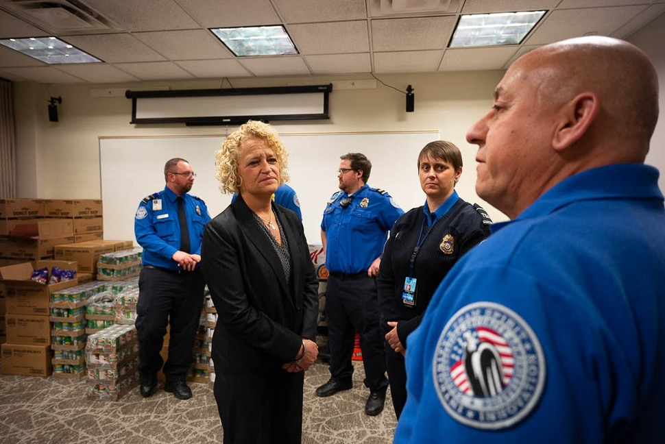 (Trent Nelson | The Salt Lake Tribune) Salt Lake City Mayor Jackie Biskupski speaks to TSA employee after having pizza delivered to TSA and other federal employees to thank them for working at the airport without pay during the partial federal shutdown on Tuesday Jan. 22, 2019. Food from the Utah Food Pantry was stacked around the training room to cover the needs of employees. From left are Ed Puhlmann, Biskupski, Anthony Christensen, Woodrina Berg, and Ronald Glujan.