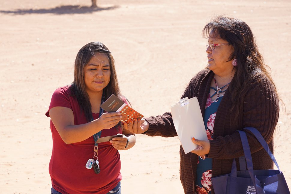 (Zak Podmore | The Salt Lake Tribune) Dalene Redhorse hands information on Plus Codes to her niece, Menvalia Redhorse, on Oct. 10, 2019.