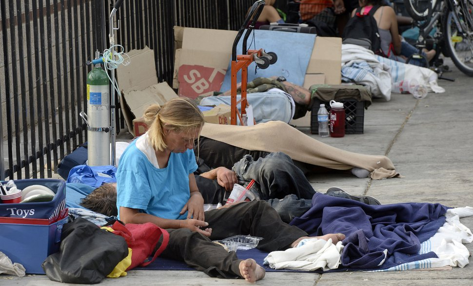 Al Hartmann | The Salt Lake Tribune People sleep on sidewalk with their belongings near 200 S. and 500 W. Wednesday morning July 19. Camping on the street is a class B misdemeanor and can now be enforced.